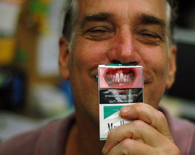 """""""Warning: Smoking causes mouth diseases"""""""