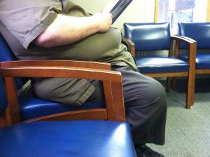 obese man in waiting area