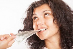 woman biting money