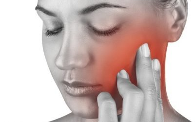 woman touching cheek in pain