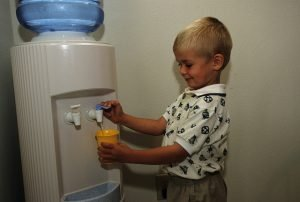 boy getting drink of water