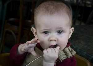 baby biting spoon