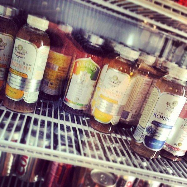 kombucha bottles in refrigerator
