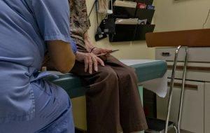 elderly woman visiting doctor
