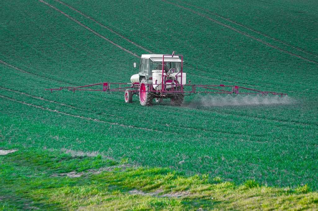 farmer spraying field