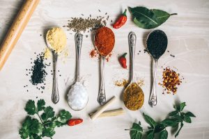 array of spices on measuring spoons