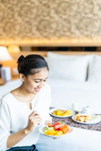 woman eating healthy meal