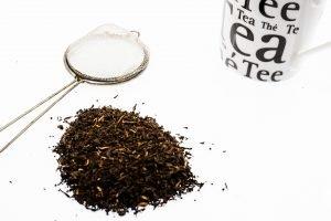 mug, leaf tea, and infuser